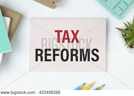 Tax Reform Text On Paper On The Desk. Business Concept For Government Change In Taxes Written On Sti