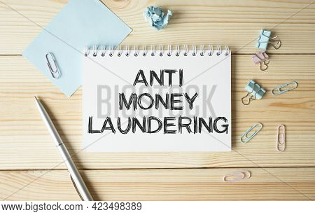 Notepad With Text Anti Money Laundering On The Office Desk With Stationery. A Blank Notepad For Ente