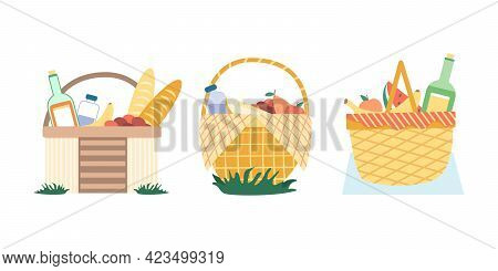 A Set Of Wicker Picnic Baskets With Wine, Water And Baguette. An Open Food Basket And Bedspread For