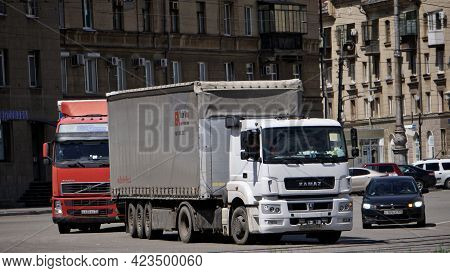 Large Five-axle Lorries Drive Along A City Street. June, 12, 2021, Russia, Magnitogorsk. Urban. Repo