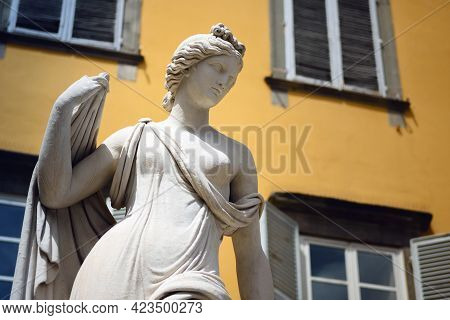 San Salvatore Square In Lucca (tuscany, Italy), Detail Of The Ancient Fountain Statue Of Venus With
