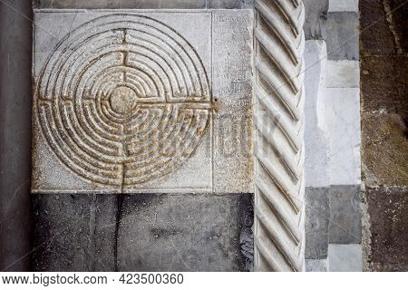 Cathedral Of Lucca (tuscany, Italy). Detail Of The Ancient Famous Maze Column On The Facade, Decorat