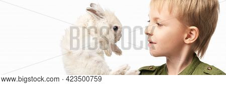 Little Pretty Boy Holding Fur Rabbit Baby. White Cute Pet At Studio. Happy Easter Hug. Male Person H
