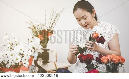 Online Home Flower Arrangement Concept, Woman Preparing To Trim Red And Pink Roses And Beautiful Flo