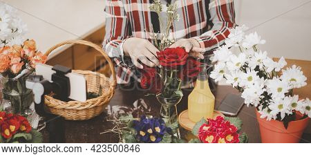 Teaching Flower Arrangements And Handsome Fresh Bouquet. Flowers Delivery. Woman Florist Create Flow