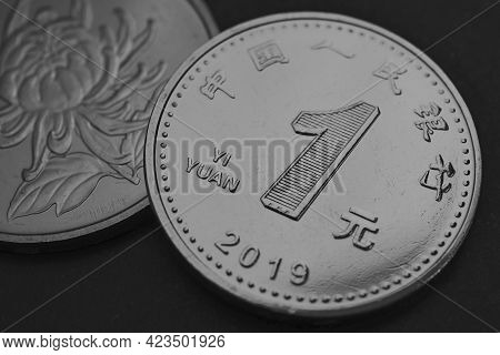 1 One Chinese Yuan Coins Close-up. Dark Gray And Black Background Or Wallpaper. Economy, Business, M