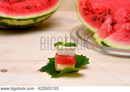 Canapes With Slices Of Watermelon Cheese And Peach, Original Snack With Fruit On A Leaf