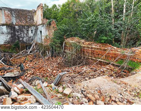 The Ruins Of An Old Abandoned Deserted Brick Building Demolition Rubble Shot As Architectural Scene.