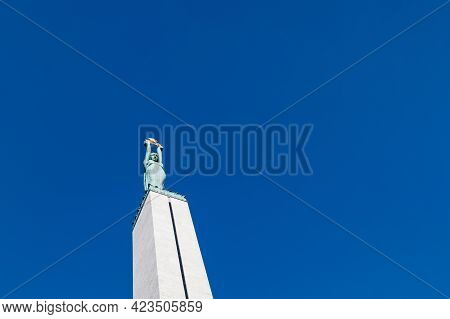 Latvian Freedom Monument On A Blue Sky Background