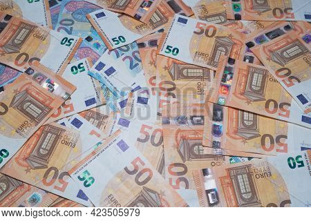 Background Of Twenty And Fifty Euro Banknotes. Soft Focus
