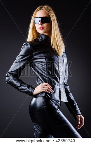 Attrative woman in leather suit