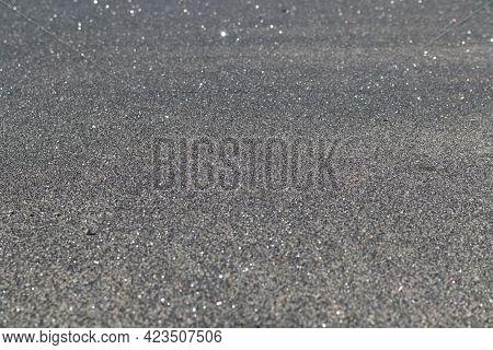 Asphalt Texture Background With Glosses. Soft Focus.