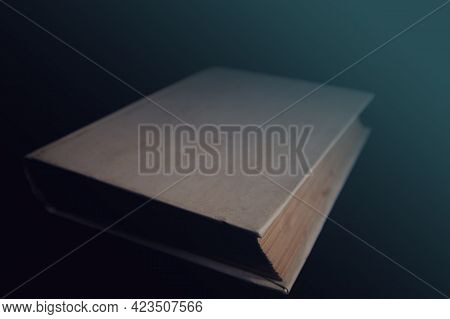 An Old Book With Blank Covers In The Dark. Soft Focus.