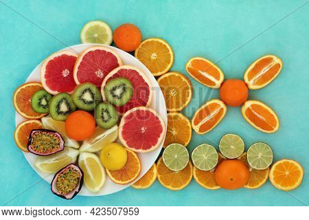 Summer sunshine fruit collection for immune system boost very high in antioxidants, anthocyanins, lycopene and vitamin c. Natural health care concept. Flat lay on mottled turquoise background.