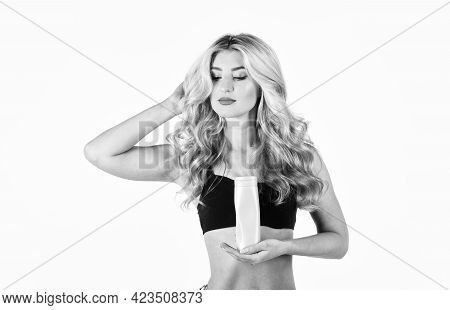 Woman Holding Bottle With Nutritional Oil Applying On Her Curly Blond Hair. Concept Hairdresser Spa