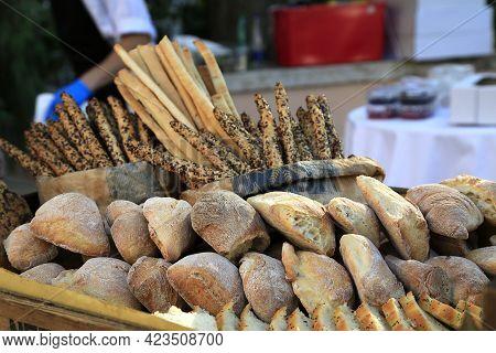 Loafs Of Fresh Crunchy Wheat Bread On E Market Shelf. Bread Sticks And Baguette In Background. Sunda