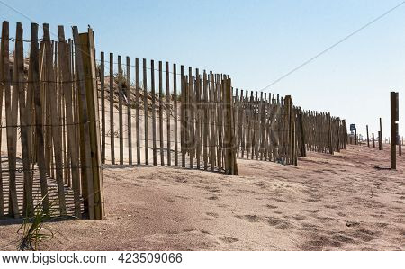 Wooden Picket Fences In Front Of The Sand Dunes For Added Protection On The Beaches Of Fire Island N
