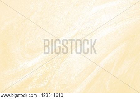 The abstract beige acrylic patterned background