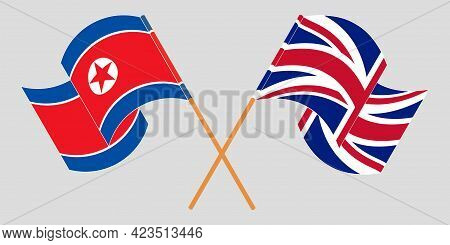 Crossed And Waving Flags Of North Korea And The Uk