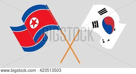 Crossed And Waving Flags Of North Korea And South Korea