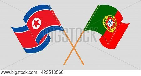 Crossed And Waving Flags Of North Korea And Portugal