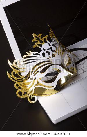 Mardi Gras Mask On A White Laptop