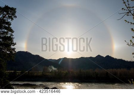Beautiful Natural Phenomenon Sun Halo With Cloud In The Sky In The Mountains.