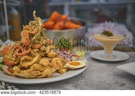 Peruvian Food: Chicharron De Pescado Or Fish Cracklings With Fried Cassava And Onion Salad With Chil