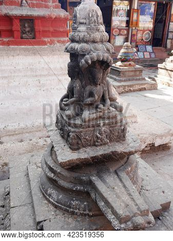 Ancient Angel Deity God Buddha Figure Nepalese Style In Small Shrine For Nepali People And Foreign T