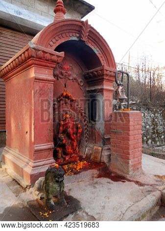 Ancient Ganesha Statue Or Ganesh Figure Lord Of Success In Small Shrine For Nepali People And Foreig