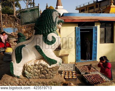 Nepali People And Foreign Travelers Travel Visit Respect Praying Lion Stone Guardian Nepalese Style