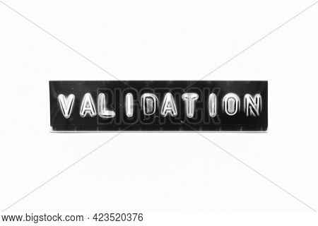 Embossed Letter With Word Validation In Black Banner On White Paper Background
