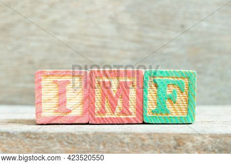 Color Alphabet Letter Block In Word Imf (abbreviation Of International Monetary Fund) On Wood Backgr
