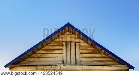 Roof With Entrance To The Attic Of The Village House.
