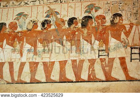 Ancient Egyptian Mural Showing Men Taking Part In A Funeral Procession On The Wall Of The Tomb Of Th