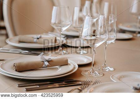 Served Dinner Table In A Restaurant. Restaurant Interior, Table Setting For A Dinner