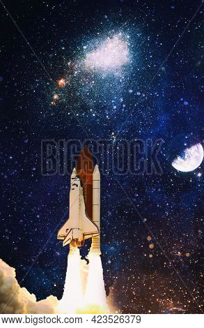 Rockets Launch Into Space On The Starry Sky. Rocket Starts Into Space Concept.elements Of This Image