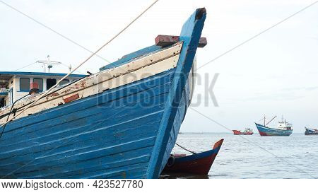 A Sea Fishing Boat On The Shore. Wooden Fishing Boat.