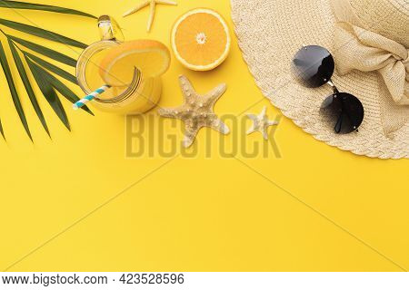 Orange Juice, Starfish, Hat And Sun Glasses On Yellow Background With Copy Space, Top View.