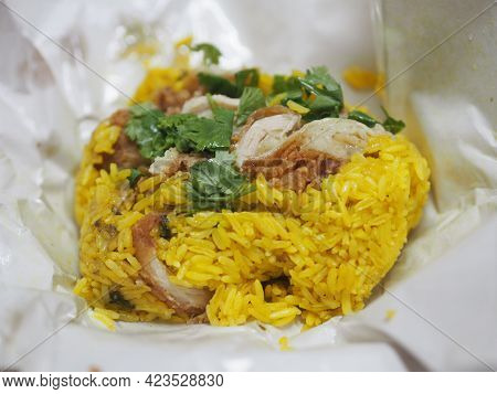 Chicken Biryani Food, Yellow Color Traditional Indian Dish Of Rice And Chicken Marinated In Spices W