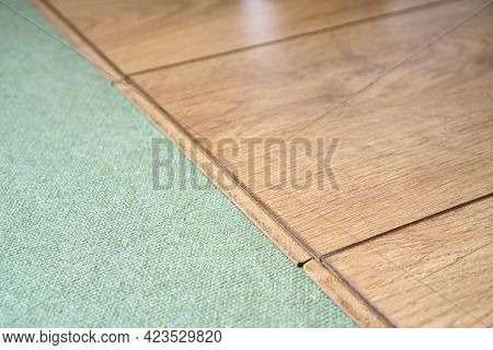 Wooden Laminated Boards On The Natural Underlay For Laminate. Quality Home Renovation Background.