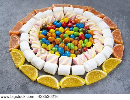 Sweets And Candies Background. Sweets Lay Folded In A Circle.