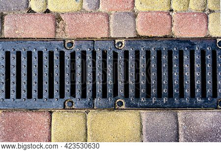 Stormwater Cast Iron Drainage System In A Pavement. Is Used For Drainage And Separation Of Water Fro