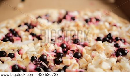 Large Round Sweet Pizza Pie With Apple Pieces, Berries, Almond Slices And Condensed Milk In A Cardbo