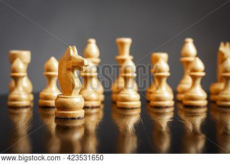 White Chess Knight, In Front Of White Pieces. Selective Focus. Strategy Of The Game, Business. Busin