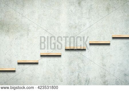 Wooden Steps On A Concrete Wall. Career Growth. Success, Growth, And Development Concept. Copy Space