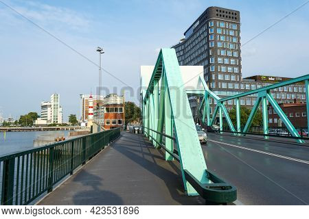 Malmo, Sweden. July 29, 2019, Beautiful Bridge Against The Backdrop Of Modern Architecture. Malmo. S