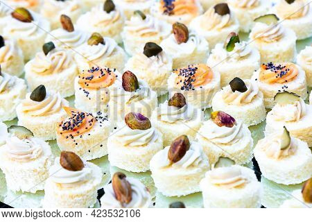 Small Canapes With Fish Cream, Pistachios And Poppy Seeds. Catering Fingerfood For Wedding. Diagonal