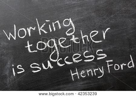 "final phrase of famous Henry Ford quote ""Coming together is a beginning. Keeping together is progress. Working together is success."" handwritten on blackboard poster"