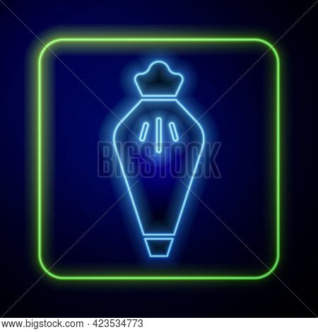 Glowing Neon Pastry Bag For Decorate Cakes With Cream Icon Isolated On Blue Background. Kitchenware